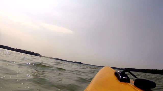 Kayaking in bad weather.