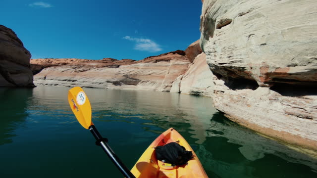 pov kayaking in canyons of powell lake recreational area - lake powell stock videos & royalty-free footage