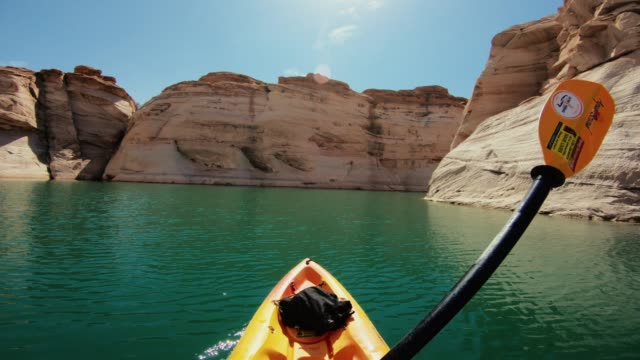 pov kayaking in canyons of powell lake recreational area - kayak stock videos & royalty-free footage