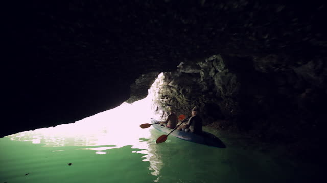ms kayaking in cave in ha long bay / vietnam - halong bay stock videos and b-roll footage