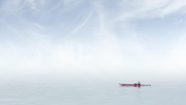 kayaking in fog - distant stock videos & royalty-free footage