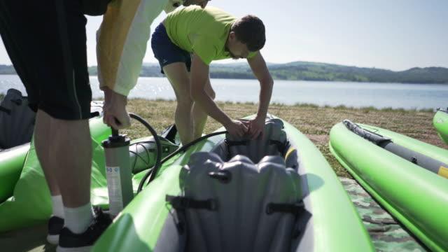 kayaking on lake - inflatable stock videos & royalty-free footage