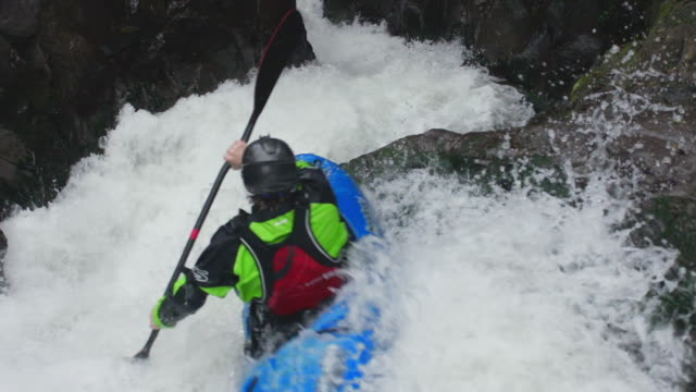 kayaking through river rapids - rafting stock videos and b-roll footage