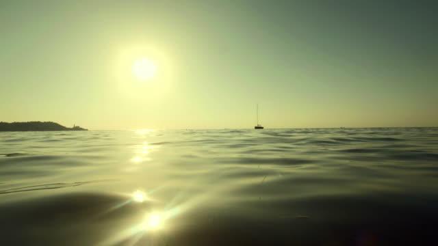 HD: Kayaking Toward The Horizon At Sunset