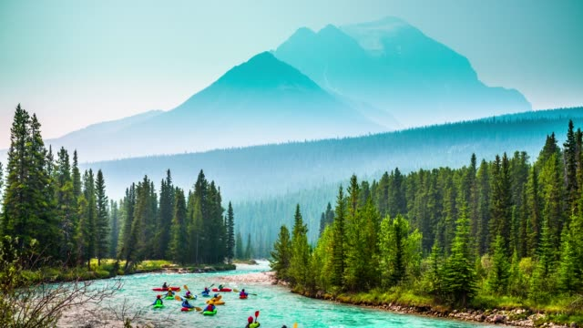 kayaks on bow river in banff national park - alberta, canada - banff stock videos & royalty-free footage