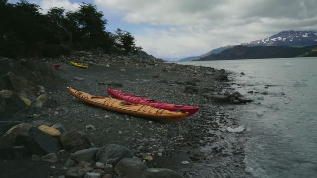kayaks on the short of grey lake near the glacier in torres del paine - kayaking stock videos & royalty-free footage