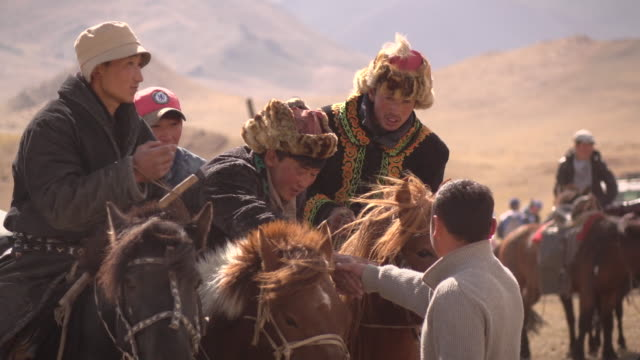 kazakh eagle hunters in mongolia at golden eagle festival - independent mongolia stock videos & royalty-free footage