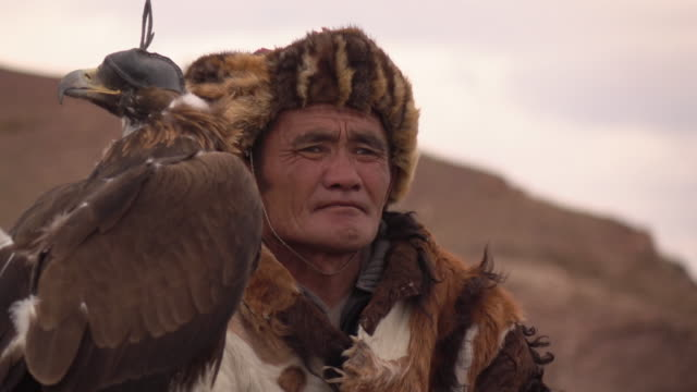 kazakh eagle hunters in mongolia at golden eagle festival - kazakhstan stock videos and b-roll footage