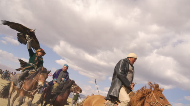kazakh eagle hunters in mongolia at golden eagle festival - independent mongolia stock videos and b-roll footage