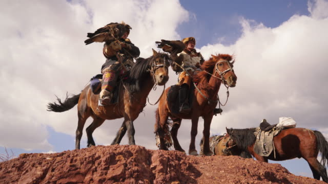 kazakh eagle hunters in mongolia at golden eagle festival - kazakhstan stock videos & royalty-free footage