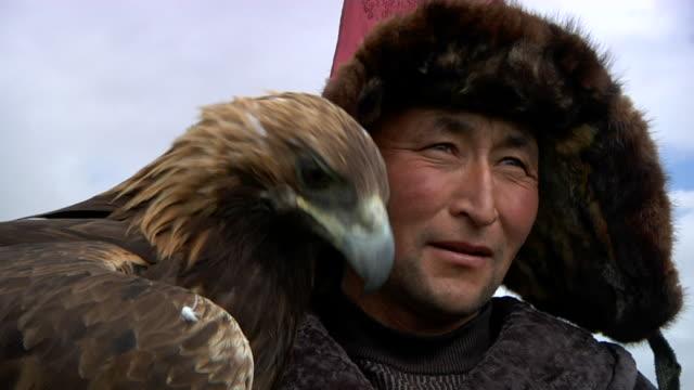 Kazakh man and golden eagle