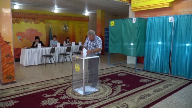 kazakhs go to the polls to elect their first new leader in 30 years following the departure of ex president nursultan nazarbayev with his handpicked... - nachfolger stock-videos und b-roll-filmmaterial