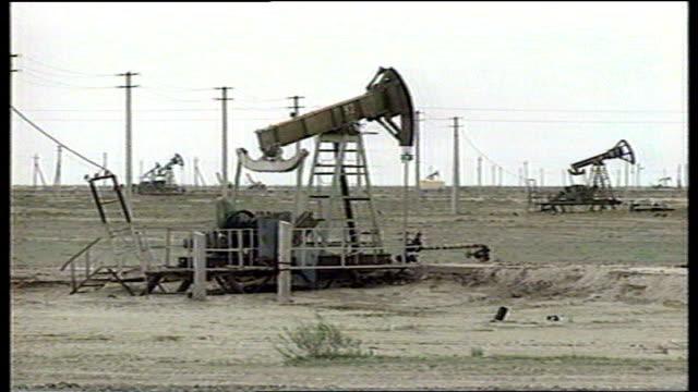 kazakhstan president visit spoof reporter 'borat' controversy tx 'nodding donkeys' at oil field int oil workers operate drilling equipment - borat sagdiyev stock-videos und b-roll-filmmaterial