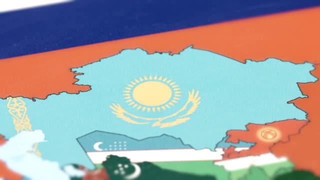 kazakhstan with national flag on world map - kazakhstan stock videos & royalty-free footage
