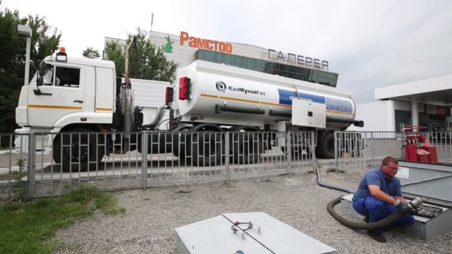 a kazmunaygasa logo sits on display above the forecourt of a gas station operated by kazmunaygas national co in almaty kazakhstan on wednesday june... - logo stock-videos und b-roll-filmmaterial
