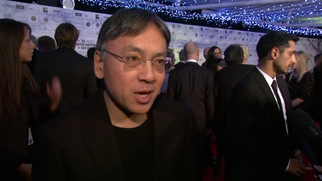 kazuo ishiguro on the team being nominated, working on the promotion circuit, his input on set at the moet british independent film awards at london... - kazuo ishiguro stock videos & royalty-free footage