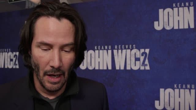 keanu reeves and film director chad stahelski talk about john wick 2 on red carpet of a gala screening of the movie. interviews feature with gvs of... - keanu reeves stock videos & royalty-free footage