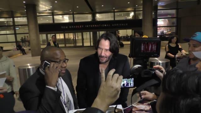 keanu reeves arriving at lax airport in los angeles in celebrity sightings in los angeles, - keanu reeves stock videos & royalty-free footage
