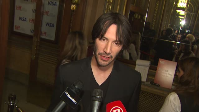 keanu reeves on on being both a producer and an actor for the film, how it feels to have the film featured at tiff and if he has ever been accused of... - keanu reeves stock videos & royalty-free footage