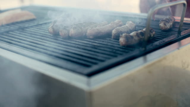 kebabce. balkan meatballs on grill - sausage stock videos & royalty-free footage