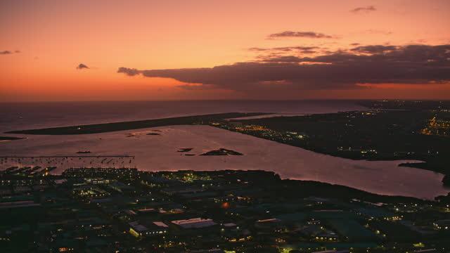 aerial keehi lagoon in honolulu, hawaii at night - oahu stock videos & royalty-free footage