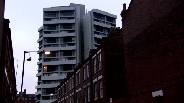 keeling house rises above a street of terraced houses in london's east end. available in hd. - east london stock videos and b-roll footage