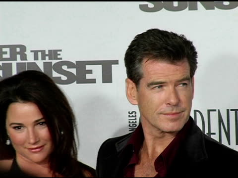 keely shaye brosnan and husband peirce brosnan at the 'after the sunset' premiere at grauman's chinese theatre in hollywood california on november 4... - keely shaye smith and pierce brosnan stock videos & royalty-free footage