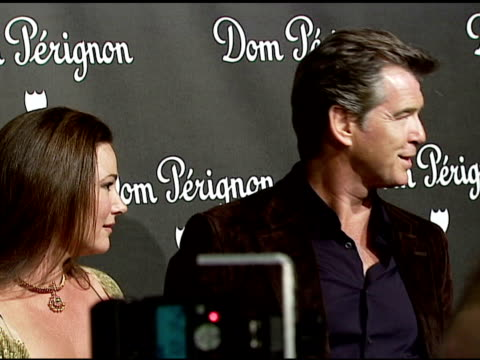 keely shaye smith and pierce brosnan at the event unveiling the new image of dom perignon rose vintage 1996 champagne at a private residence in... - keely shaye smith and pierce brosnan stock videos & royalty-free footage