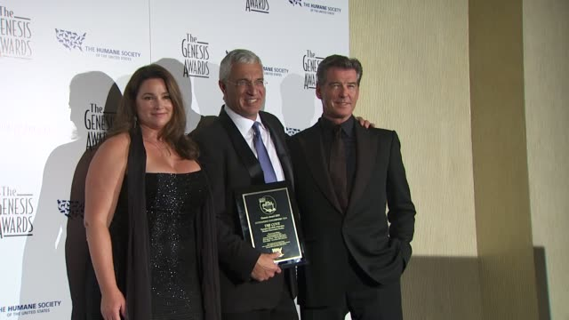 keely shaye smith louie psihoyos pierce brosnan at the 24th genesis awards at beverly hills ca - keely shaye smith and pierce brosnan stock videos & royalty-free footage