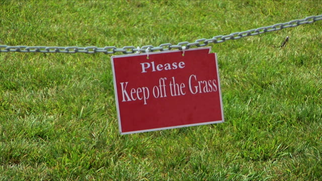 ms 'keep off the grass' sign, san diego, california, usa - hanging sign stock videos and b-roll footage