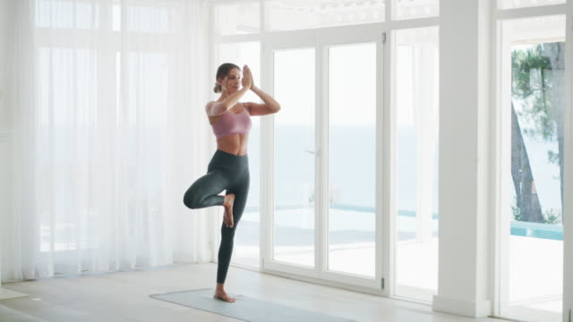 keep your balance in check - pilates stock videos & royalty-free footage
