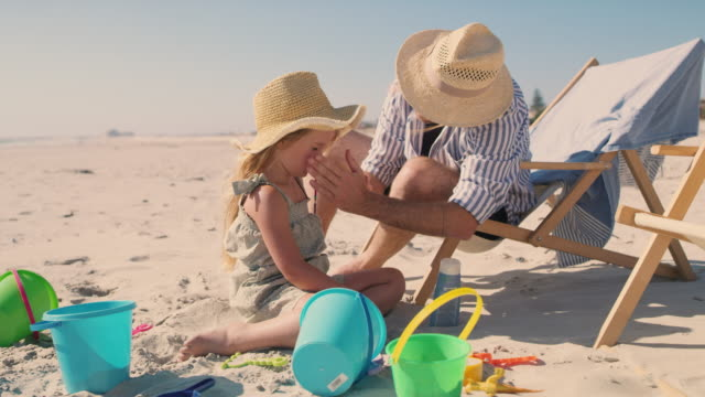 keep your kids sunburn-free this summer - protection stock videos & royalty-free footage