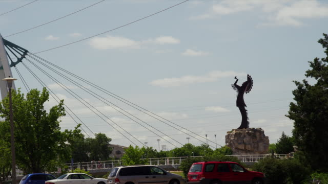 """""""keeper of the plains"""" native american statue with river and city park - wichita stock videos & royalty-free footage"""