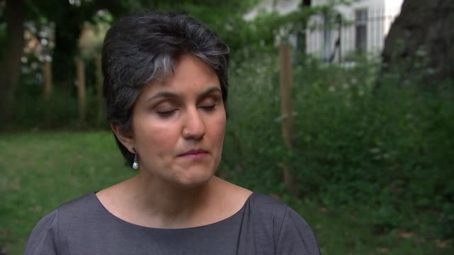 Keeping fit and eating healthily can help prevent dementia London EXT Dr Naaheed Mukadam interview SOT Brain scan seen on computer monitor People...