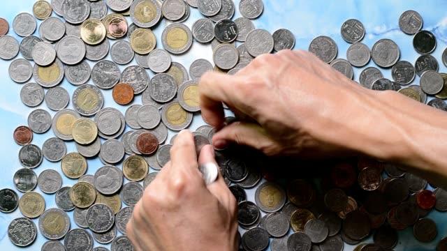 管理マネー - 25セント硬貨点の映像素材/bロール