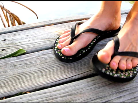 keeping time with feet - flip flop stock videos and b-roll footage