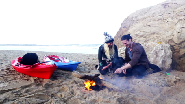 Keeping Warm by the Fire after Kayaking
