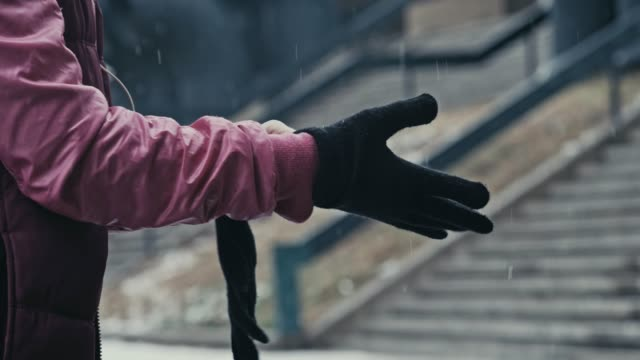 keeping warm - glove video stock e b–roll
