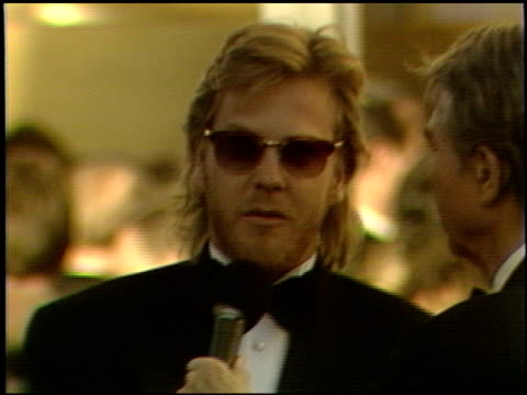 keifer sutherland at the 1989 academy awards at the shrine auditorium in los angeles, california on march 29, 1989. - shrine auditorium stock videos & royalty-free footage