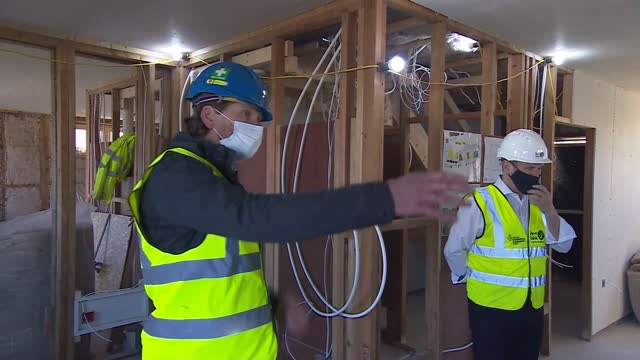 keir starmer campaigning in wales; wales: gower: ext/int various shots of newly built house and buildings under construction / keir starmer mp , mark... - politics video stock e b–roll