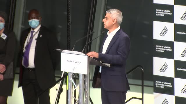keir starmer carries out limited reshuffle of shadow cabinet; england: london: city hall: int sadiq khan along to podium and speech excerpt sot - i... - channel 4 news stock videos & royalty-free footage
