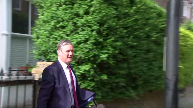 keir starmer, labour leader, leaves his house, surrounded by reporters, for his first meeting with his newly reshuffled shadow cabinet, after... - horizontal stock videos & royalty-free footage