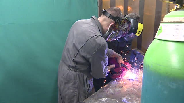 keir starmer, labour leader, on visit to training college in west midlands, uses soldering equipment in car workshop - welding stock videos & royalty-free footage