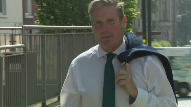 keir starmer mp, labour leader, walking towards camera with jacket slung over shoulder, yorkshire - taking a break stock videos & royalty-free footage