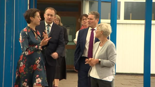 keir starmer visits school in stevenage; england: hertfordshire: stevenage: ext keir starmer mp arriving from car and chatting with headteacher,... - mp stock videos & royalty-free footage
