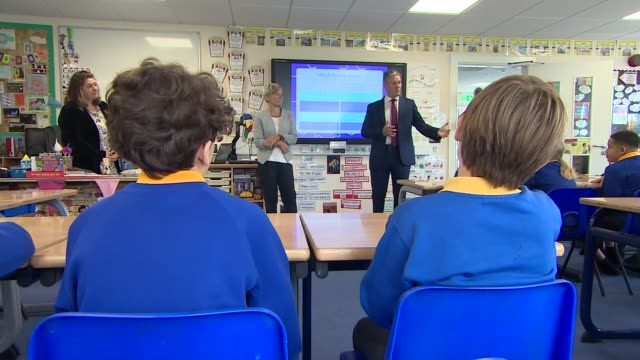keir starmer visits school in stevenage; england: hertfordshire: stevenage: ext keir starmer mp chatting with headteacher, teachers and kate green mp... - mp stock videos & royalty-free footage