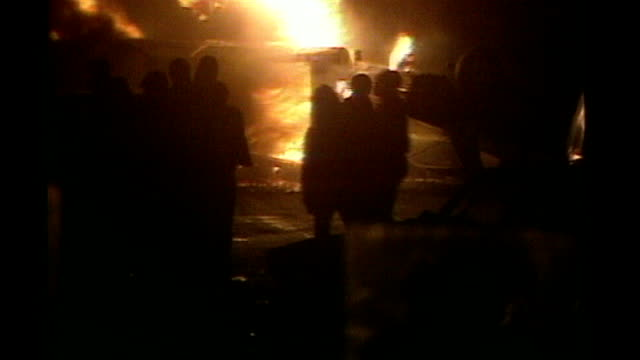 Nicky Jacobs too stressed to attend news conference AS061085010 / Tottenham Broadwater Farm Estate Rioters in silhouette in street with flames from...