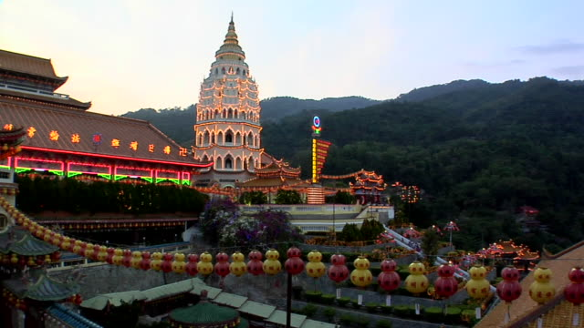 ws pan kek lok si temple illuminated for chinese new year at evening / ayer hitam, penang, malaysia - penang stock videos and b-roll footage