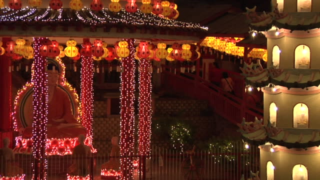 ws zo kek lok si temple illuminated for chinese new year at evening / ayer hitam, penang, malaysia - penang stock videos and b-roll footage