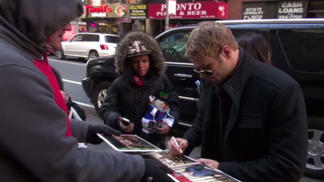 Kellan Lutz arrives at the Today show in Rockefeller Center and signs for and poses with fans in Celebrity Sightings in New York 01/08/13